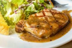 Grilled pork steak and vegetables Stock Images