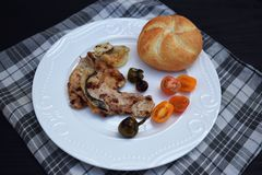 Grilled Pork steak and vegetables . Hot Meat Dishes. Top view. Grilled Pork steak and vegetables . Hot Meat Dishes Royalty Free Stock Photography