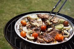 Grilled Pork steak and vegetables . Hot Meat Dishes. Top view. Grilled Pork steak and vegetables . Hot Meat Dishes Stock Images