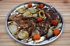Grilled Pork steak and vegetables . Hot Meat Dishes. Top view. Grilled Pork steak and vegetables . Hot Meat Dishes Stock Photo
