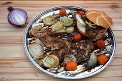 Grilled Pork steak and vegetables . Hot Meat Dishes. Top view. Grilled Pork steak and vegetables . Hot Meat Dishes Stock Photos