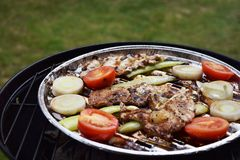 Grilled Pork steak and vegetables . Hot Meat Dishes. Top view. Grilled Pork steak and vegetables . Hot Meat Dishes Stock Photography