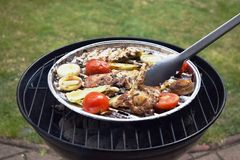 Grilled Pork steak and vegetables . Hot Meat Dishes. Top view. Grilled Pork steak and vegetables . Hot Meat Dishes Stock Image