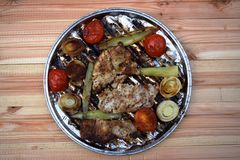 Grilled Pork steak and vegetables . Hot Meat Dishes. Top view. Grilled Pork steak and vegetables . Hot Meat Dishes Royalty Free Stock Images
