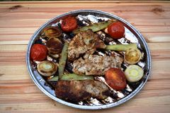 Grilled Pork steak and vegetables . Hot Meat Dishes. Top view. Grilled Pork steak and vegetables . Hot Meat Dishes Royalty Free Stock Photos