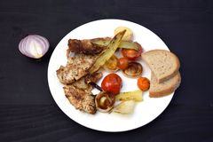 Grilled Pork steak and vegetables . Hot Meat Dishes. Top view. Grilled Pork steak and vegetables . Hot Meat Dishes Royalty Free Stock Image