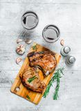 Grilled pork steaks with red wine. On a rustic background stock photos
