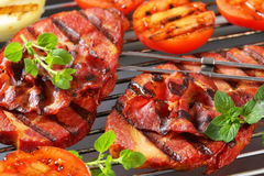 Grilled pork steaks and vegetables Royalty Free Stock Photos