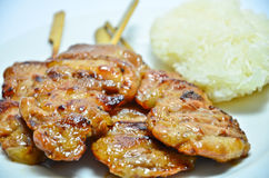Grilled pork with sticky rice Royalty Free Stock Images