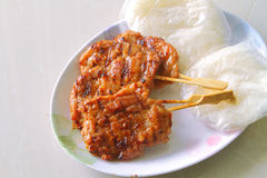 Grilled pork with sticky rice. Close-up of grilled pork with sweet spicy sauce and sticky rice on plate: Thai street food royalty free stock image