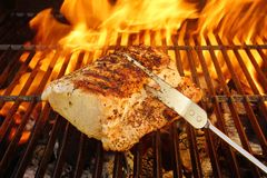 Grilled Pork Striploin, Fork and BBQ Flames Royalty Free Stock Image