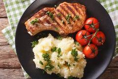 Grilled pork T-bone steak garnished with mashed potatoes close-u Stock Photos