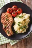 Grilled pork T-bone steak garnished with mashed potatoes close-u Stock Image