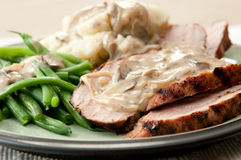Grilled pork tenderloin. With a rich mushroom sauce, red skinned mashed potatoes and fresh green string beans Royalty Free Stock Photos