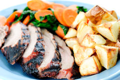 Grilled pork tenderloin brined, served with potato wedges and Royalty Free Stock Images
