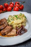 Grilled pork tenderloin. With mashed potatoes and glazed onion stock photos