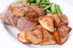 Grilled pork tenderloin medallions with apple and sweet onion sa Stock Photos