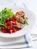 Grilled Pork Tenderloin with Pepper -Tomato Salsa and Arugula Salad royalty free stock images