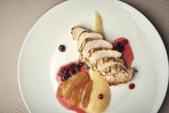 Grilled pork tenderloin with pomegranate souce and potato royalty free stock photography