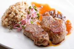 Grilled pork tenderloin with prunes Stock Photos