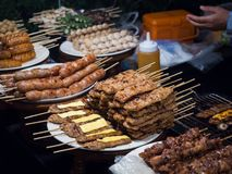 Grilled pork top cheese with sweet sauce, Thai style sausage on plate in street food stock photo