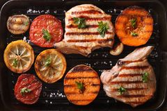 Grilled pork and vegetables on the grill pan. top view horizonta Royalty Free Stock Photos