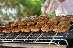 Grilled pork with wood stick Royalty Free Stock Photos
