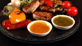Grilled porks fillets with roasted vegetables stock video
