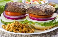Grilled portabella burger. Stock Photos
