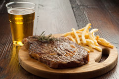 Grilled porterhouse with french fry Stock Images