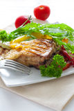 Grilled portion of flounder with vegetables Stock Image