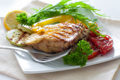 Grilled portion of flounder with vegetables Royalty Free Stock Photo