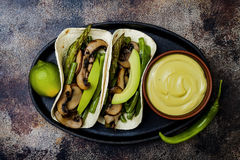 Grilled portobello, asparagus, bell peppers, green beans fajitas. Poblano mushroom tacos with jalapeno, cilantro, avocado crema. Vegan tacos with green summer Royalty Free Stock Images