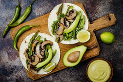 Grilled Portobello, Asparagus, Bell Peppers, Green Beans Fajitas. Poblano Mushroom Tacos With Jalapeno, Cilantro, Avocado Crema Stock Photos