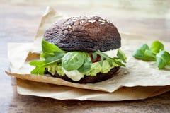 Grilled portobello bun mushroom burger. Vegan, gluten free, grain free, healthy veggies hamburger with guacamole, fresh vegetables Stock Images