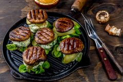 Grilled portobello bun mushroom burgers on cast iron grill pan ob wooden background, top view.  stock images
