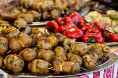 Grilled potato on a plate. Popular street food Royalty Free Stock Images