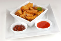 Grilled potato wedges with home made spicy sauce Stock Photo