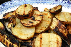 Grilled potatoes with black pepper Stock Images