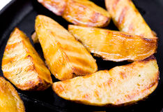 Grilled potatoes, macro Stock Images