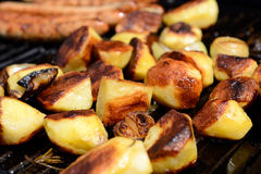 Grilled potatoes and sausage Royalty Free Stock Photo
