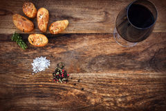 Grilled potatoes with spices on old wood Stock Photography