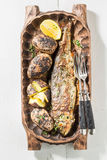 Grilled potatoes and trout fish with butter and herbs Royalty Free Stock Images