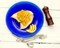 Grilled poulet fillet with oranges sauce over blue plate and vin Stock Image