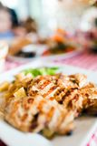 Grilled poultry meat with vegetables. Served in restaurant Royalty Free Stock Photos