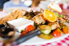 Grilled poultry meat with vegetables. Served in restaurant Stock Photos