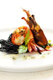 Grilled prawn. A dish of grilled prawn with salad and squiz spaghetti, spread with white sauce and garnish with caviar Stock Images