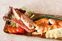 Grilled Prawn. Delicious Grilled Prawn with lemon, tomato, vegetables Stock Photography