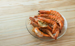 Grilled prawn. Roasted prawn on wood table royalty free stock images