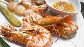 Grilled prawn with spicy paste. Grilled prawn served with spicy chilli paste on white dish Royalty Free Stock Photos
